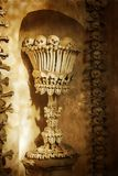 Skulls and bones. Kutna Hora, Czech Republic. textured old paper Royalty Free Stock Image