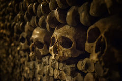 Skulls and bones in Paris Catacombs Royalty Free Stock Photo