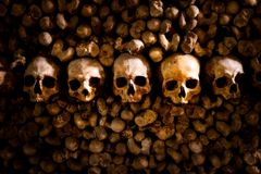 Skulls and bones in Paris Catacombs. France Stock Photo