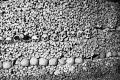 Skulls and Bones - Scary Skulls and Bones in the Catacombs of Paris Royalty Free Stock Photography