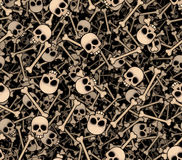 Skulls and bones. Seamless background Stock Photos