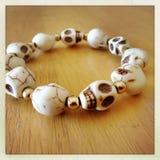 Skulls bracelet Stock Image