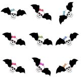 Skulls with colored bow and bat wings. Seamless pattern. On white background Stock Photography