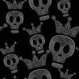 Skulls with crowns on black background - seamless psychedelic pattern Royalty Free Stock Photo
