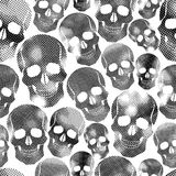 Skulls with halftone print texture seamless background, black an Royalty Free Stock Photos