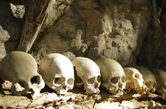 Skulls lined up at a traditional burial site. Horrifying skulls at a funeral site, a traditional burial place with hanging graves in Toraja Highlands, Sulawesi Royalty Free Stock Photos