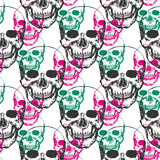 Skulls print. Skull pattern in black, pink and green color. Seamless skulls with color triangle for textile, fabric, wrapping. Vec Stock Photos