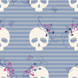 Skulls seamless pattern. Seamless pattern with funny skulls, flowers and butterflies Stock Image