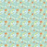 Skulls seamless pattern with light green background Royalty Free Stock Photography