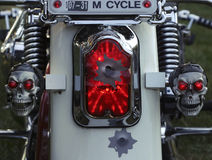 Skulls and Tail Light. Detailed motorcycle from behind showing close view of two skulls and tail light Stock Photography