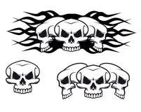 Skulls tattoo. Danger skulls as a tattoo or evil concept Stock Photos