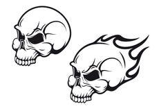 Skulls tattoo. Danger skulls as a tattoo or evil concept Stock Images