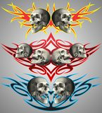 Skulls on tribal design Royalty Free Stock Photography