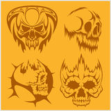 Skulls with tribal elements vector set. Stock Photo