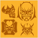 Skulls with tribal elements vector set. Royalty Free Stock Photos