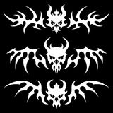 Skulls with wings. Set of stylized skulls with wings in tribal style. White illustration on black background Stock Image