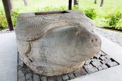 Skulptera den stensköldpaddaJin Empire eran, det 13th århundradet Arkivbilder