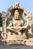 Skulptur av Narasimha monoliter sned in situ, Hampi royaltyfri foto