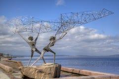 Skulptur av TVÅ FISKARE Royaltyfri Bild