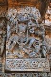 Skulptur av Varaha, 10th inkarnation av Vishnu, Hoysaleshwara tempel, Halebidu, Karnataka sikt från västra Arkivbild