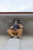 Skulptur för hög lättnad av den amerikanska cowboyen dekorerade med keramiskt, Arkivfoto