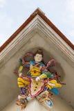 Skulptur för hög lättnad av Nezha, kinesisk gud som dekoreras med cera Royaltyfria Bilder
