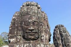 Skulptur för sandstenhuvud i den forntida Bayon templet Royaltyfri Fotografi