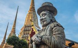 Skulptur för stenThailändsk-kines stil och thai konstarkitektur i den Wat Phra Chetupon Vimolmangklararm Wat Pho templet Royaltyfria Foton