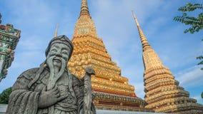 Skulptur för stenThailändsk-kines stil och thai konstarkitektur i den Wat Phra Chetupon Vimolmangklararm Wat Pho templet Royaltyfri Foto