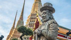 Skulptur för stenThailändsk-kines stil och thai konstarkitektur i den Wat Phra Chetupon Vimolmangklararm Wat Pho templet Fotografering för Bildbyråer