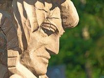 skulptur i den wood framsidan Royaltyfri Bild