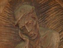 skulptur i den wood framsidan Royaltyfria Bilder