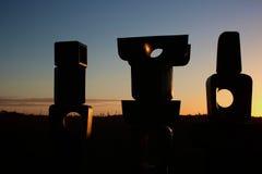 Skulptur im Sonnenaufgang Stockbild