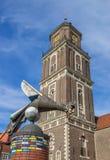Skulptur och kyrkligt torn i Coesfeld arkivbild