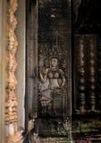 Skulptur på väggen i templet Royaltyfri Foto