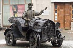 Skulpturbankir och bilist Arkivbild