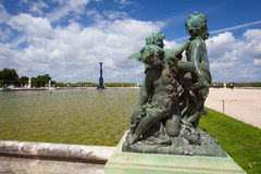 Skulpturer i trädgård av den Versailles slotten Arkivbild