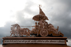 Skulpturhäst med lagledaren Arkivbild