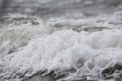 Skum i havsvågor Royaltyfri Fotografi