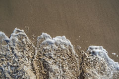 Skumma av havet Arkivbild
