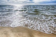 Skumma på sanden Arkivbild
