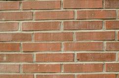 Skupiająca się tekstura pomarańczowy stały ściana z cegieł Fotografia Royalty Free