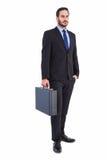 Skupiający się biznesmen trzyma teczkę Zdjęcia Stock