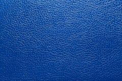 Skvalpad yttersida för bakgrund textur under hudmörker - blå färg Arkivfoto