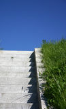 Into the sky. Stone steps leading upwards, deep blue sky in the background royalty free stock photos