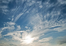 Sky. A blue sky with clouds and sun Royalty Free Stock Images