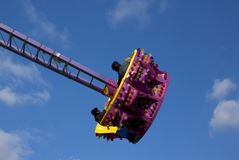 In the sky. Swinging gondola on an amusement park ride Royalty Free Stock Images