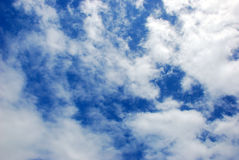 Sky. White clouds in a spring blue sky Stock Photography