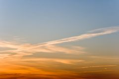 The sky. Magically shined clouds in the sky and has shined by evening sun. Sun has given to them soft warm tone Royalty Free Stock Images
