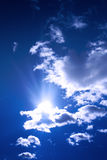 Sky. Serene scene of sun showing up behind a cloud stock image